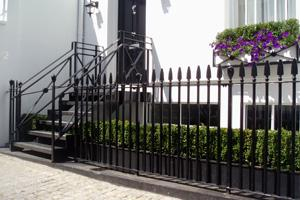 Custom made classic style entry staircase balustrade and cast iron railings